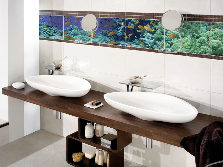 #Tile and natural stone specialist #Kerana refines tiles individually or in the form of a border, to match custom templates. Here an underwater motif complements the wash basin with the Axor #Massaud collection