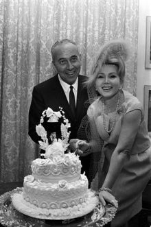 Actress Zsa Zsa Gabor and industrialist Herbert Hutner cut their wedding cake.  They were married 1962-1966. He was number four of her nine husbands. She has been married since 1986 to her current husband, Frédéric Prinz von Anhalt.  She's 96 (2/2/1917) and in ill health.