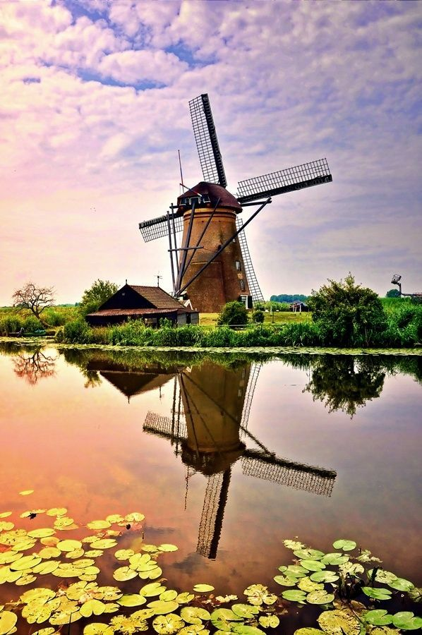 Windmill Kinderdijk, Netherlands by Edi Nugraha, via 500px ....(Kinderdijk is a village in the Netherlands, belonging to the municipality of Molenwaard, in the province South Holland, about 15 km east of Rotterdam.)