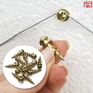 """The """"Best-ever"""" way to hang pictures & more - no matter the type of hanger! Why does hanging pictures, mirrors and wall décor, have to be so difficult? Trying to find studs, or drilling large holes is the thing of the past! Simply insert these attractive brass button head screws and you're done! The secret is the large diameter, extremely thin threads that displace little plaster but hold on super strong. They hold up to 30 lbs!"""