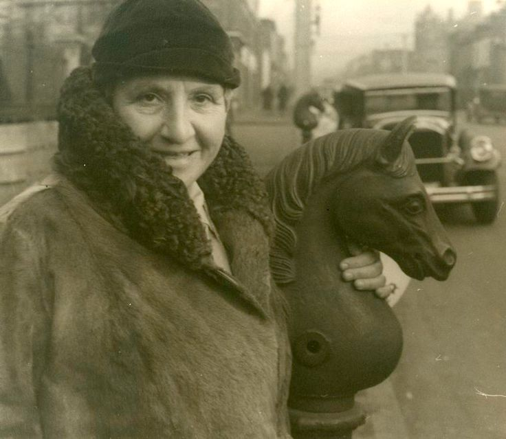 Image ID: 483821  Gertrude Stein, Richmond, Virginia. With an old hitching post. February 7, 1935. ([1937-1948])