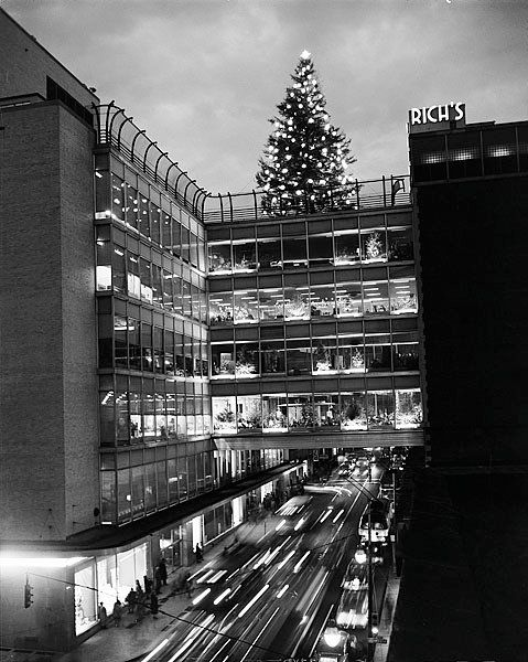 """1950s pic of the Rich's Christmas tree atop the """"crystal bridge"""" in Atlanta."""