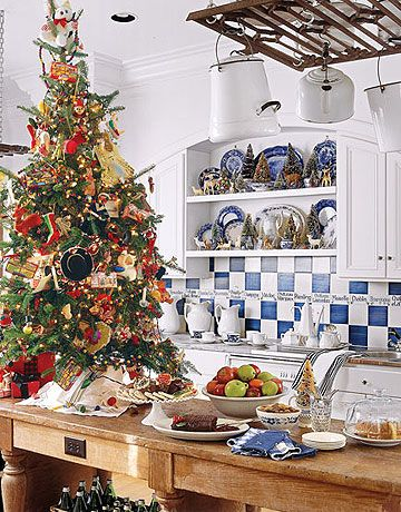 Kitchen Christmas Tree:   This small tree, along with mini trees in teacups on shelves, makes a cheerful setting for a casual holiday breakfast.   Photo Credit: Keith Scott Morton
