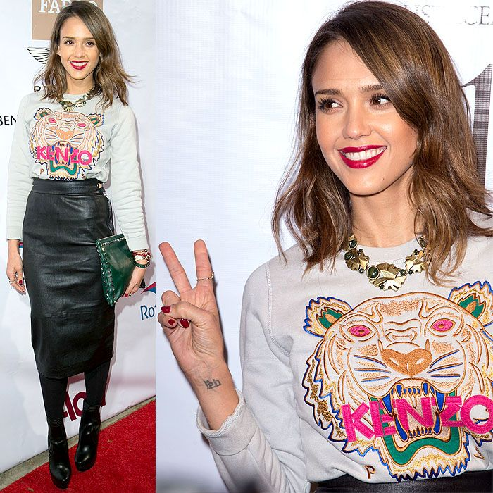 Jessica Alba opted for the street-style-favorite Kenzo tiger sweatshirt and paired it with an almost mumsy high-waisted, knee-length leather skirt