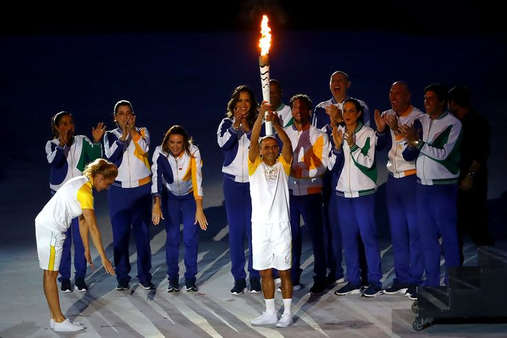RIO DE JANEIRO, BRAZIL - AUGUST 05:  Former athlete Vanderlei de Lima carries the Olympic Torch during the Opening Ceremony of the…