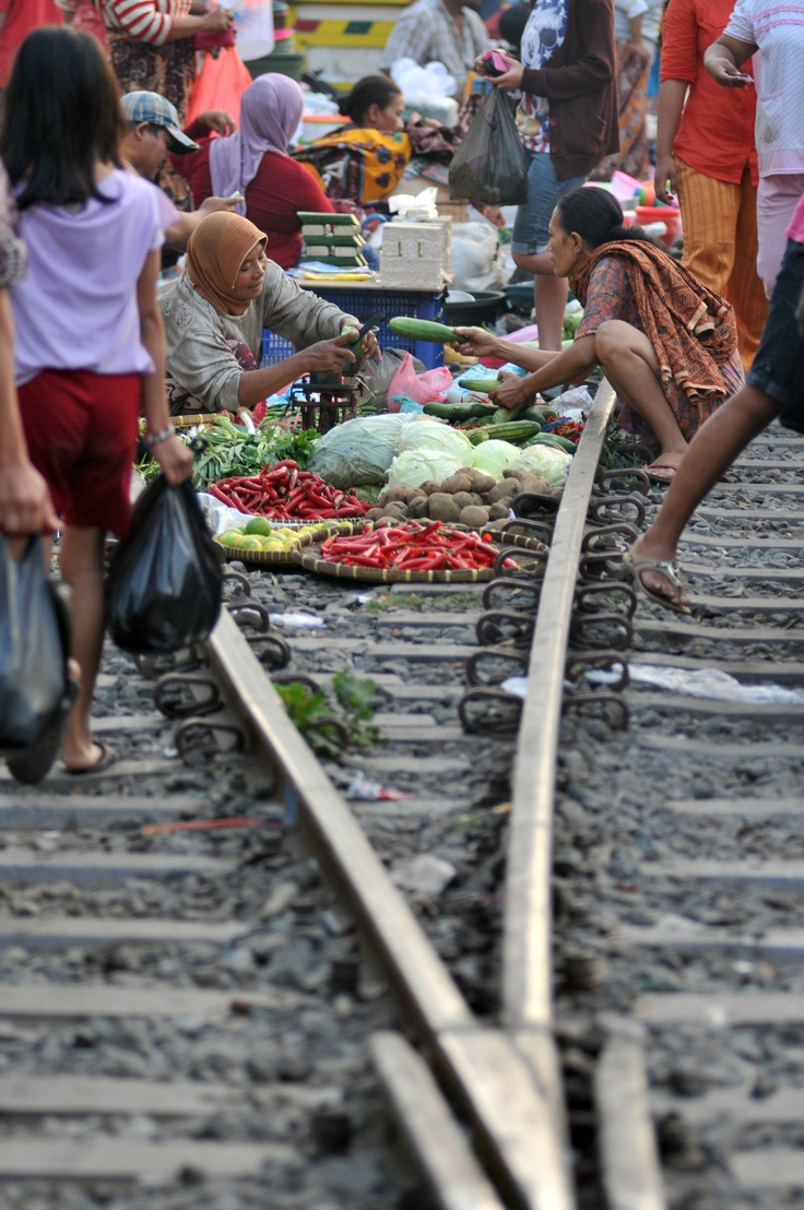 Food hawkers ply their wares on the railroad tracks in Surabaya, East Java, on June 23, 2012. The vendors have refused to follow  government order to move to a safer, but more remote location. The seller say they prefer trading on the tracks because they are closer to their train-bound customers. (Antara Photo/M Risyal Hidayat)