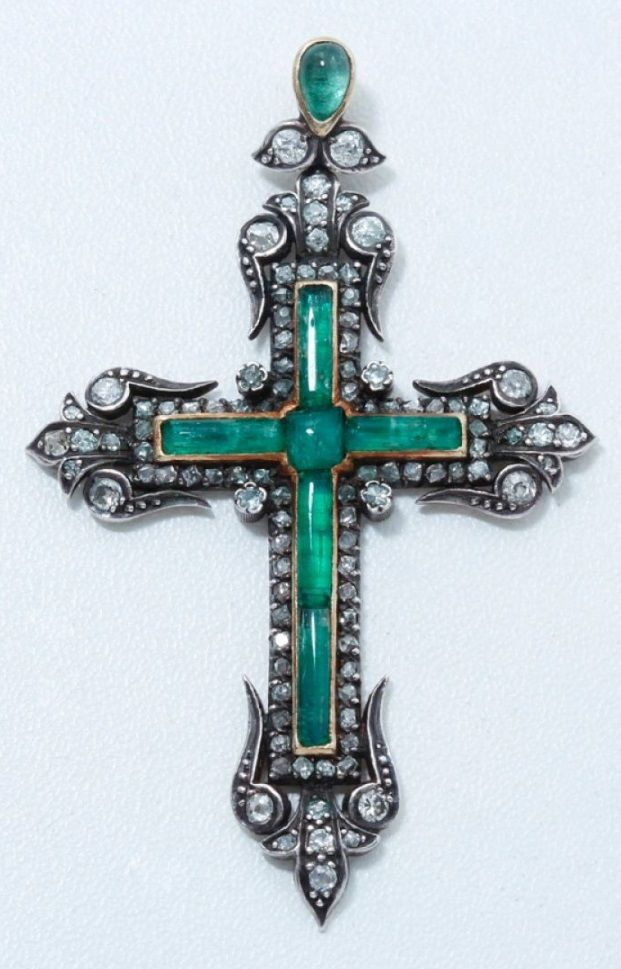 An antique silver, gold, emerald and diamond pendant, 19th century. Designed as a cross, set with cabochon emeralds mounted in gold, surrounded by old-cut diamonds mounted in silver. Length 6cm. #antique #cross #pendant