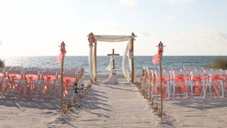 Watermelon sashes, our wooden cross and floral accents - Florida beach wedding delight