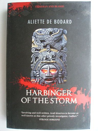 "The novel ""Harbinger of the Storm"" by Aliette de Bodard was published for the first time in 2011. It's the second in the ""Obsidian And Blood"" series and follows ""Servant Of The Underworld"". Cover of a British edition. Click to read a review of this novel!"