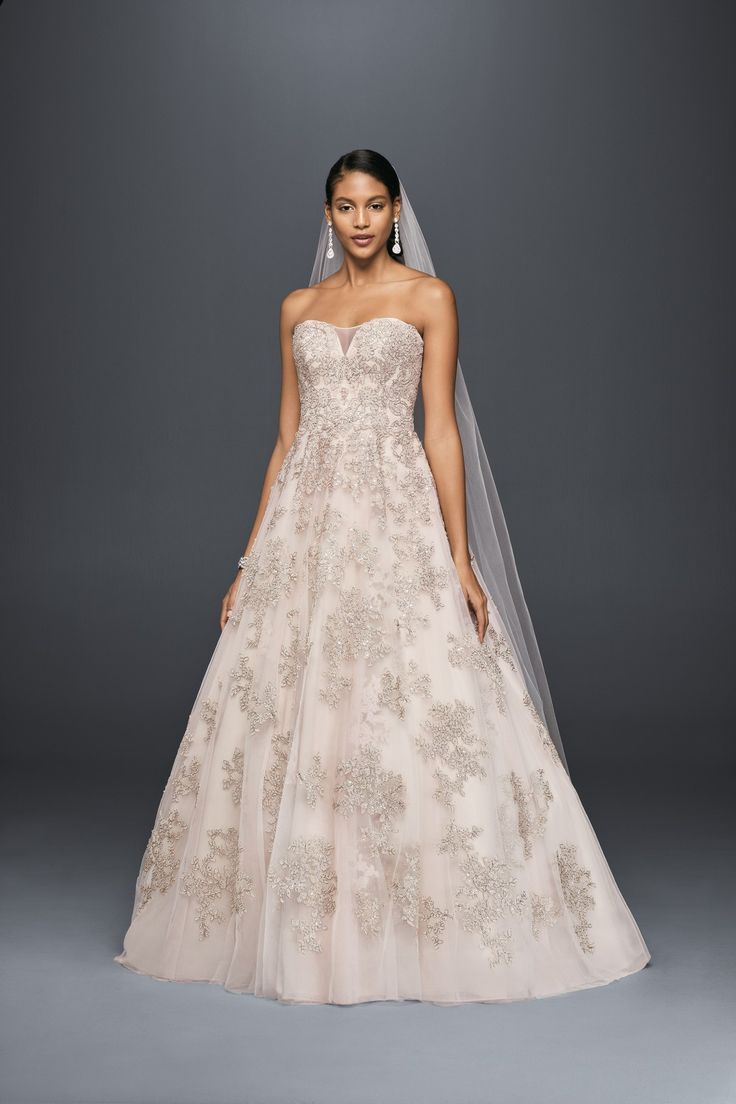tones of blush pink and rose gold lend this illusion bodice a line gown