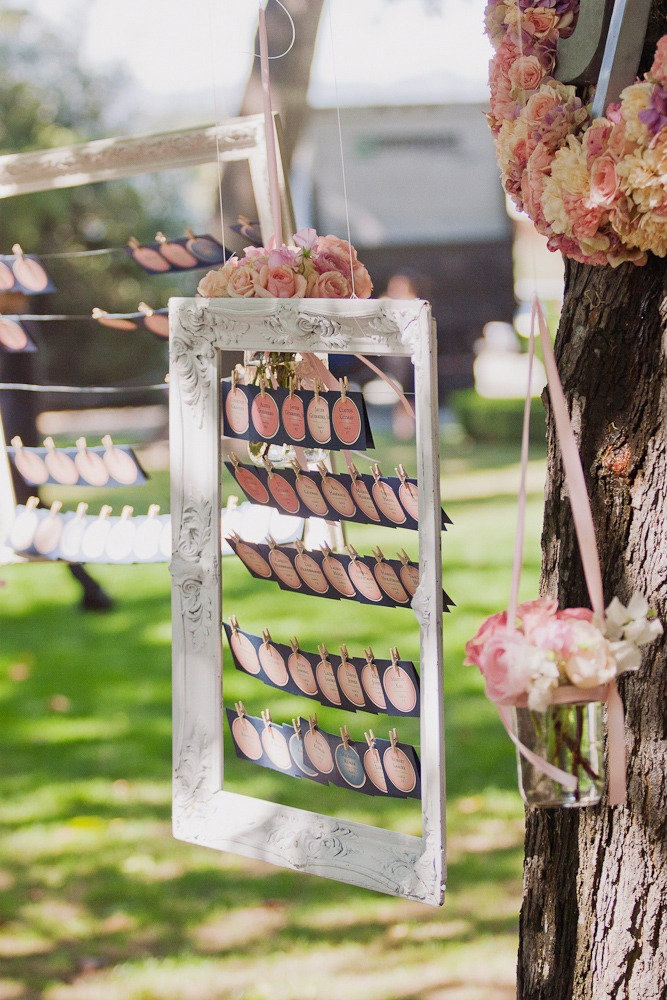We pin lots of escort card displays ~ kind of really love this one! On http://StyleMePretty.com/2012/04/16/charles-krug-winery-wedding-from-jennifer-skog-amazae-special-events Photography by jenniferskog.com, Event Design by amazaespecialevents.com