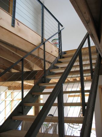Hey all you sleek expensive modernist architects with square toed shiny shoes and funny little glasses! Check this out. I designed this very cool steel stair out of stock pieces of steel – two C-channels and a bunch of 1 1/2″ steel angle. Lots of nuts and bolts. Add some...