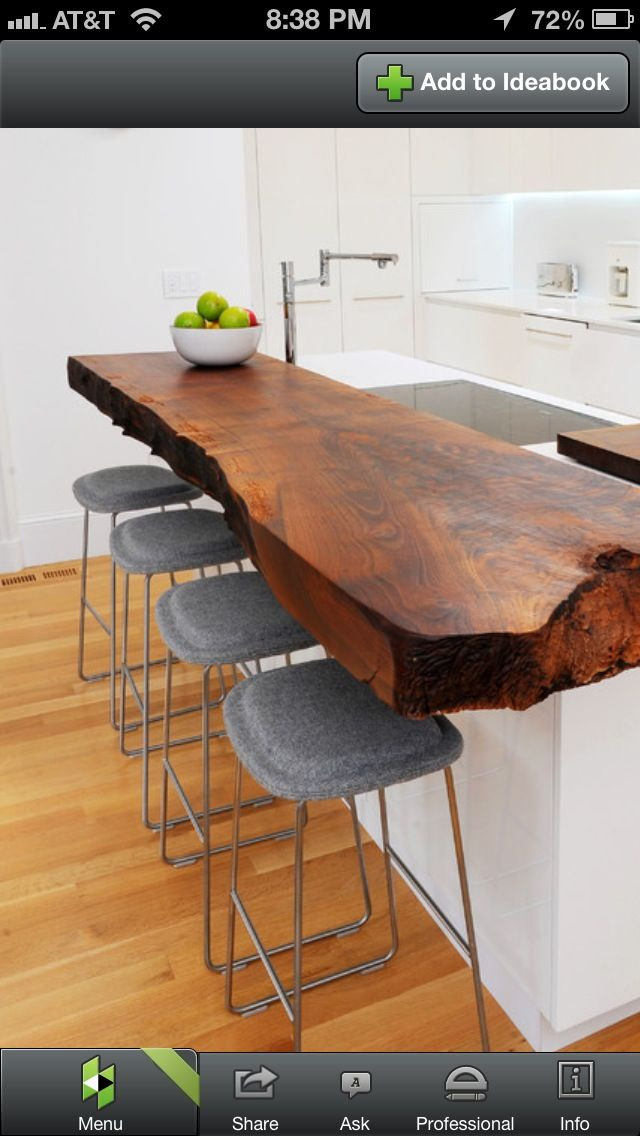 """"""" Distressed Wood Counter"""" NOT THE JAGGED EDGES BUT I LIKE THE COLOR OF THIS WOOD AND THE WAY THAT YOU CAN SEE THE VARIATION OF THE WOOD GRAINS. I THINK DISTRESSED WOOD WOULD BE A SAFE OPTION AS LONG AS THE COLOR OF THE WOOD WENT ALONG WITH OUR WALL AND FLOOR COLORS."""