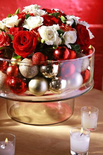 Floral arrangement in a chip and dip bowl. Fill chip party with ornaments and set the flower in the dip part. Brilliant!