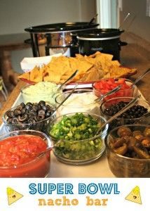 super bowl nacho bar . . . tortilla chips, melted cheese, seasoned ground beef, chopped tomatoes, green onions, black olives, sliced jalapeños, black beans, guacamole, salsa, & sour cream