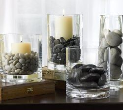 I love this idea for candles decorating, I want to do this with four graduating cylinders and candles on a square plate and then put sand around the cylinders.