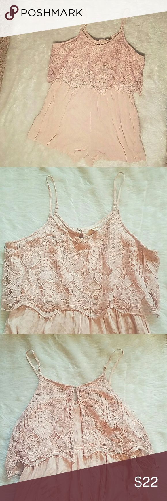 NWOT dusty rose color Romper NWOT dusty rose color Rompers with adjustable shoulder straps, lace bodice is 100% polyester, bottom is 100% rayon, fully lined Shorts