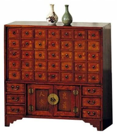 Chinese Medicine Chest: The hand-crafted reproduction of a 41 drawer medicine cabinet is based on the old Asian chests used to store herbal remedies. Made of beautiful elm wood, it's also decorated with Chinese lettering. - would it be wrong to make this my makeup/crafting case????