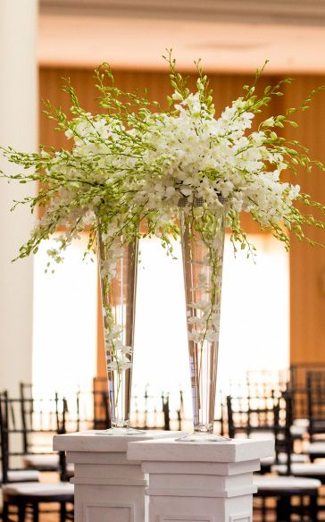 Elegant centerpiece idea using trumpet style vases. What can we create for you ?     Photography by Procopio in the Maryland and D.C., etc. areas.