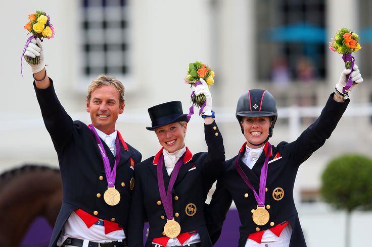 Carl Hester riding Uthopia, Charlotte Dujardin riding Valgero, Laura Bechtolsheimer riding Mistral Hojris on the podium at London 2012