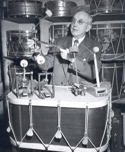 William F. Ludwig Sr. holds one of his first bass drum pedals.