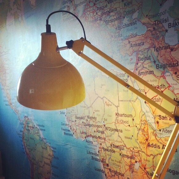 Love the yellow lamp against the map wall