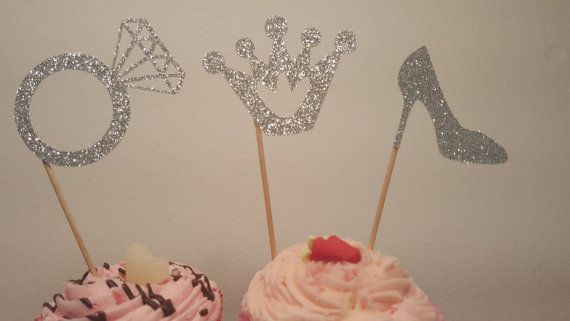 Check out this item in my Etsy shop https://www.etsy.com/uk/listing/236237871/rings-and-crown-cake-toppers-andor