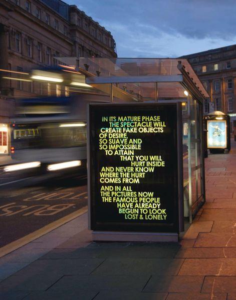 urban poetry - Robert Montgomery. Poetry over back-lit bus stops and billboards.