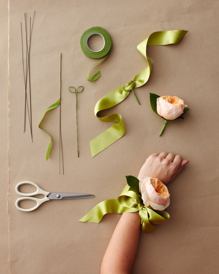 """A wrist corsage is only as old-fashioned as its design. To give yours a modern look, choose a flower that is """"big and elegant,"""" like a gardenia or a flat garden rose, and opting for a ribbon base over an elastic band."""