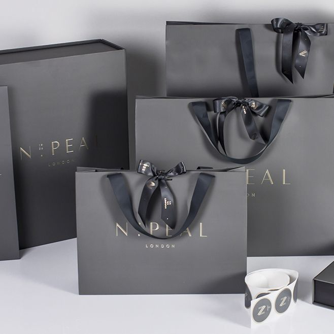 Following the successful re-brand of luxury cashmere retailer N.Peal, their glamorous new packaging range is now making an impact in store. The bespoke embossed paper chosen by N.Peal. has been used to create a range of bags, boxes and accessories befitting the luxury and elegance of the brand. With the addition of intricate foiling, luxury grosgrain handles and superior quality paper and print, it's clear to see the exclusivity the new branding has achieved...