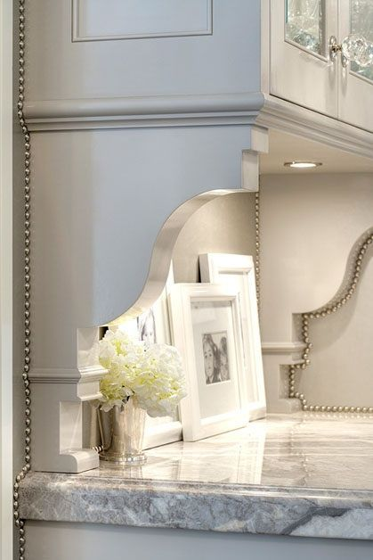 cabinets go from builder grade to custom just by adding brackets under the counter and nailhead trim