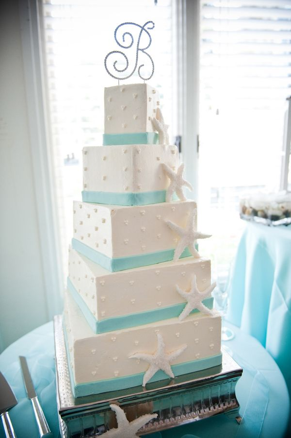 White five diagonal tiered square wedding cake with aqua borders, white starfish designs, and a 'B' monogrammed topper - photo by Portland wedding photographer Barbie Hull