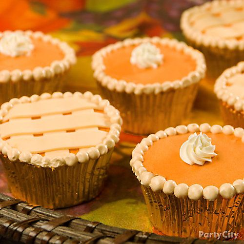 """Whip up your family's favorite pumpkin pie, only this year, try it in chic miniature. Make baby versions by baking the pie in cupcake tins, then create the """"pie crust"""" by piping frosting on the top. Make a delectable display on a generous serving tray and watch as these trendy treats become the new Thanksgiving classic!"""