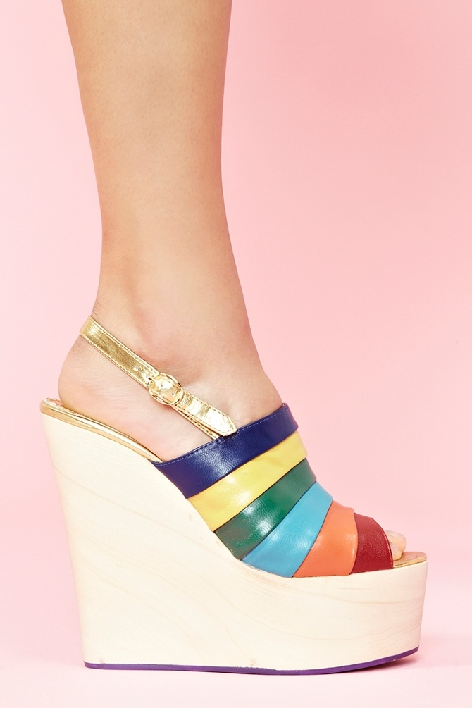 If I wasn't so clumsy that I would end up killing myself in these shoes, I think I would need these.  Chica Chola Platform Wedge - Rainbow