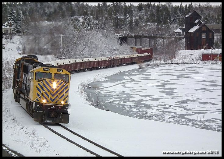 Believe it or not, this is April 23rd, 2015. We're at the historic silver mining community of Cobalt along the Temagami Subdivision as Wayne, Jeff, and Craig run SD75I's 2105 & 2101 and SD40-2 1734 for all they're worth as 214's 94 cars are pulled uphill while the train journeys south from Englehart to North Bay.