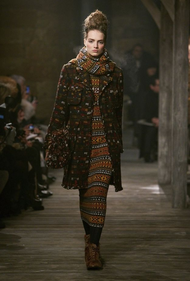 Rule 10: If you leave the house and realize your purse doesn't have any homemade-looking pom poms on it, go back inside and glue on some cat toys. | 29 Photos Of Chanel's Etsy-Victorian-Grunge Pre-Fall Fashion Show