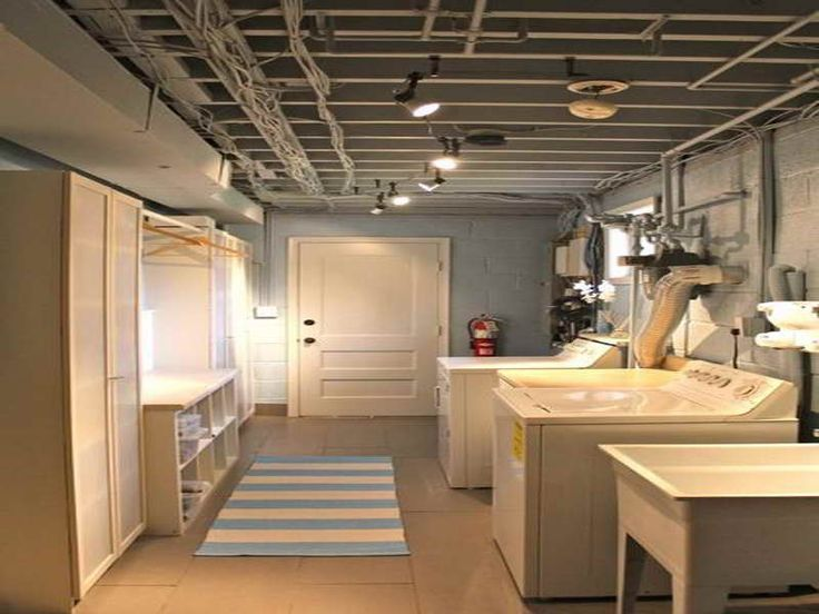 Comfortable Basement Laundry Room Design Ideas With White Washing Machine  And Wood Interior Door Also Low Ceiling And Nice Carpet Ideas | Pinterest |  White ...