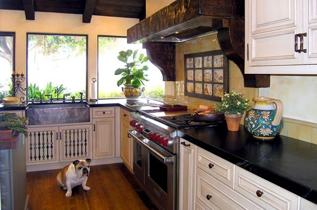 eclectic spanish revival kitchen with painted cabinets wall tile hammered copper apron sink. Black Bedroom Furniture Sets. Home Design Ideas
