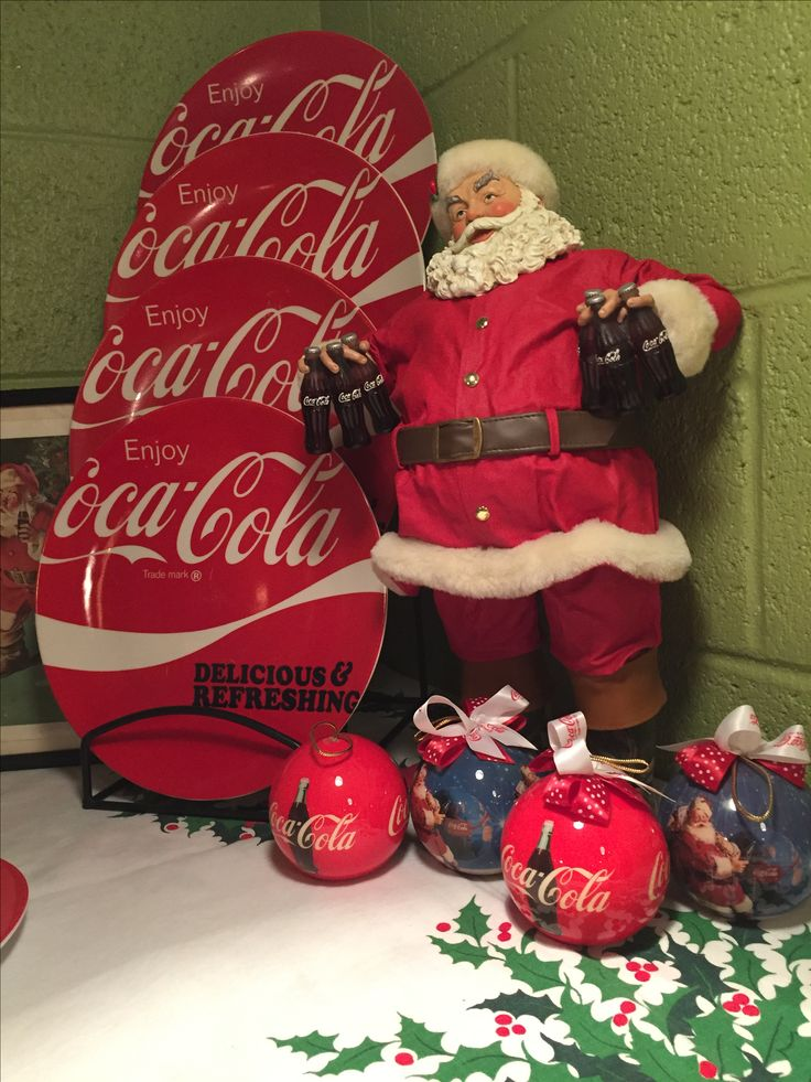 Kurt Adler Coca Cola Santa Claus with Coca Cola plates.