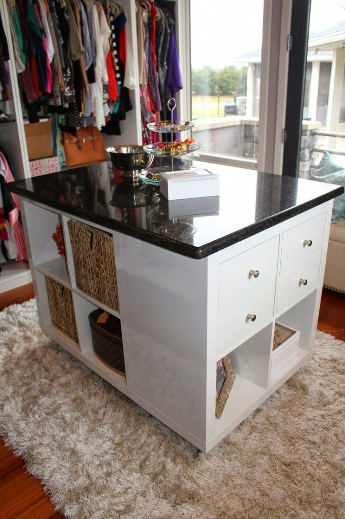 Lovely glamourous Ikea hack, using 4 Expedit/Kallax closets, drawers, baskets and a countertop. Must remember this one for our linen room!