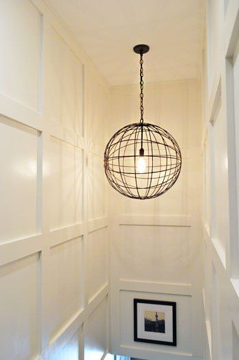 Trim on stair walls, cool light fixture
