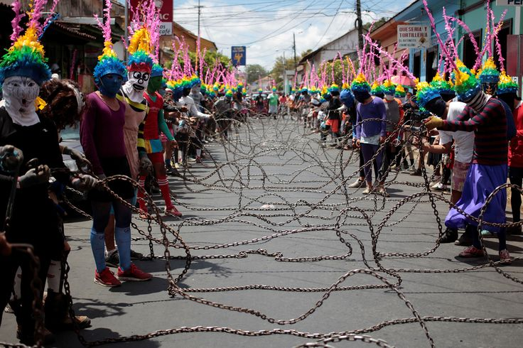 """People take part in a procession called """"The Chained"""" during Holy Week celebrations in Masatepe, Nicaragua, on April 13, 2017."""