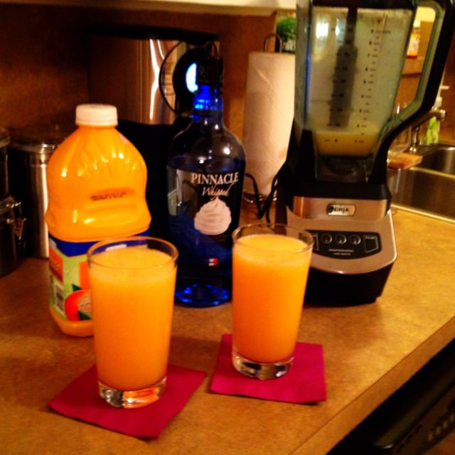 Dreamsicle!  2 ounces whipped cream vodka, 4 ounces of OJ--- add ice and blend till smooth!!!!