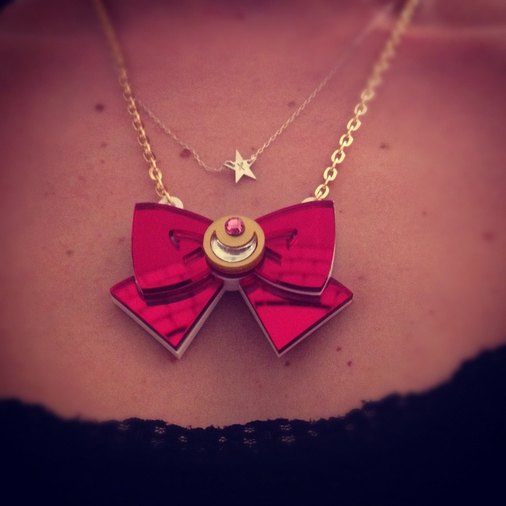 Sailor moon bow red mirror laser cut necklace. €20.00, via Etsy.