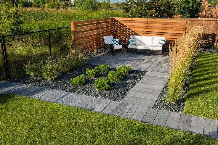 Enjoy a warm summer afternoon in this corner patio with Bridgewood Slabs.