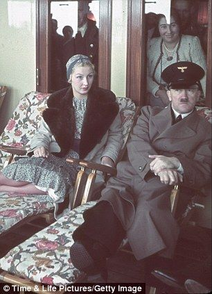 Adolf Hitler, wearing an Arbeitsfront cap, aboard the KDF Ship Robert Ley on its maiden voyage with Inge Ley (Robert Ley's wife) in 1939. German workers were offered free cruises through the 'Strength through Joy' scheme.