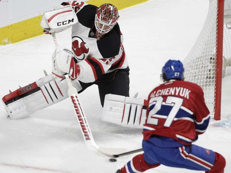 Jan.06 2016 - NJ 1 - Mtl 2 - Alex Galchenyuk of the Montreal Canadiens tries to get the puck from New Jersey Devils goalie Cory Schneider in the first period at the Bell Centre in Montreal on Wednesday, Jan. 6, 2016.