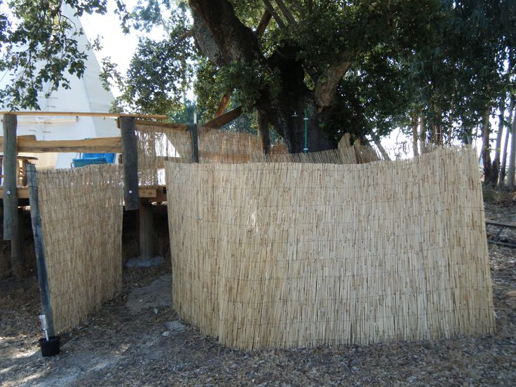 private shower and compost toilet next to tipi