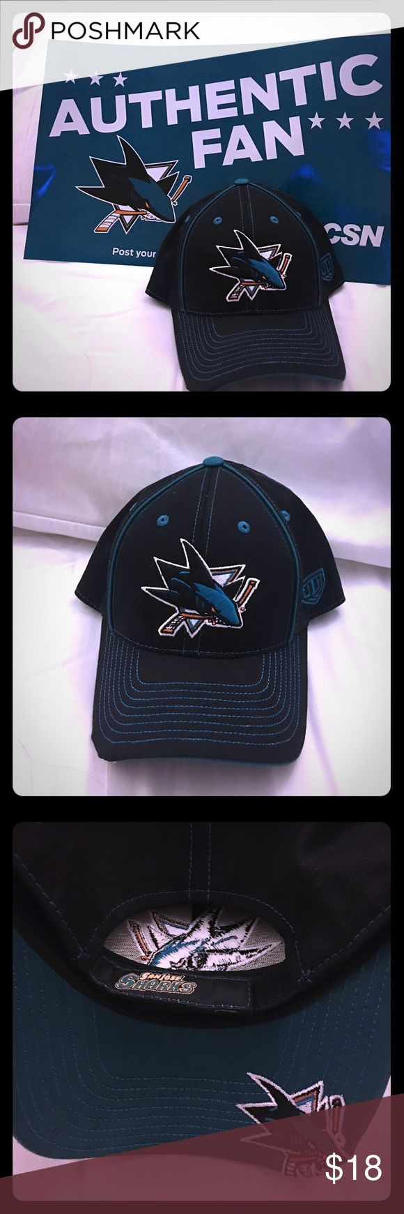 ⛸ San Jose Sharks Adjustable Cap Get ready for another exhilarating San Jose Sharks Playoffs run with this NHL licensed adjustable cap. Black with teal stitching and unique Shark logo on under brim. Accessories Hats