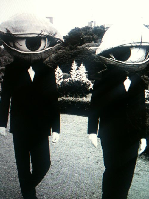 Hilarious and creepy idea: dressing up with a friend as a pair of eyeballs.